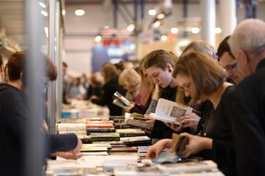 People choose books at the indoor book market