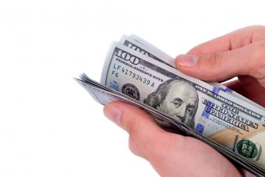 hand holding hundred dollars on white background
