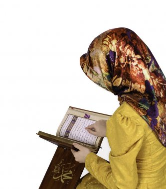Muslim girl in hijab reading Al Quran on a white background