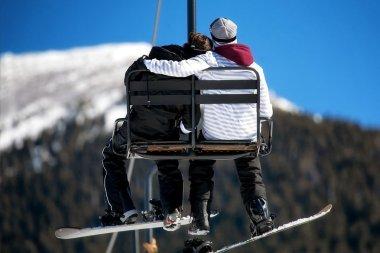 couple embracing on Ski Lift