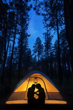 Couple  romantic evening in a camping