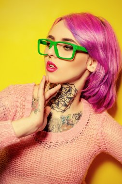 hair coloring. Optics style. Tattoo.