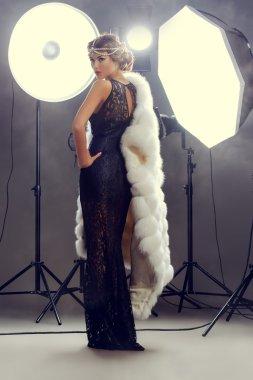 Stunning beauty model posing at studio in light flashes. Professional fashion model. Celebrity. Full length portrait. stock vector