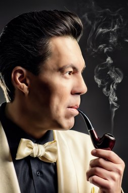gentleman smokes a pipe