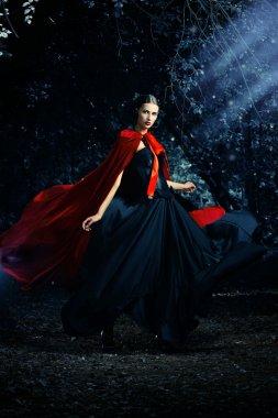 lady in cloak
