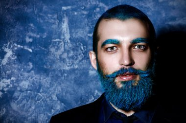 folktale hero. Dark portrait of a handsome man with blue beard.