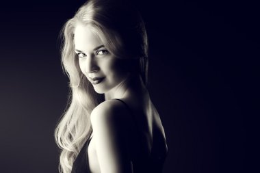 womanly smile. Black-and-white portrait of a gorgeous blonde woman.