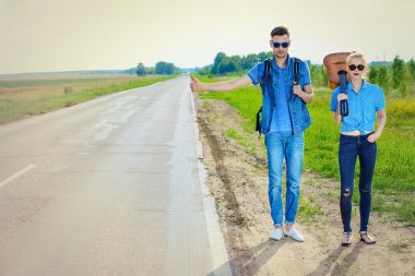 romantic trip. Hitchhiking couple.