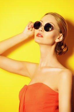 Beautiful elegant lady over bright yellow background. Beauty, fashion concept. Optics. stock vector