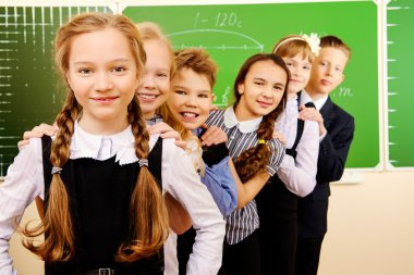 Happy schoolchildren at a classroom. Education. stock vector