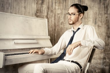male pianist thoughtful