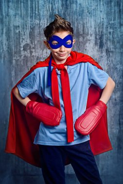 superboy. teenager in a costume of superhero.