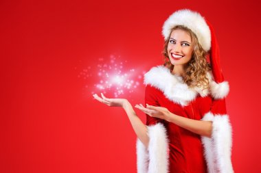 presentation, young woman in Santa Claus clothes