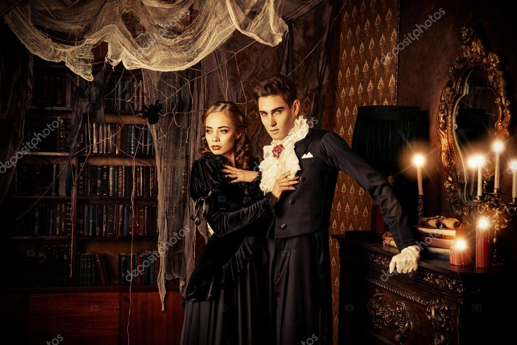 Beautiful Man And Woman Vampires Dressed In Medieval Clothing Stand A Room Of The Old Abandoned Castle Halloween Photo By Prometeus