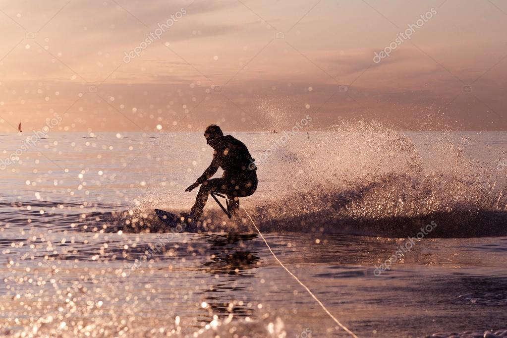 Wakeboard ride on tranquil waters at a sunset