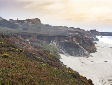 Ocean coast and cliffy rocks on the beach in California