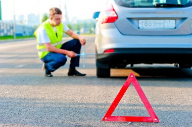 warning triangle and help the mechanic on the road