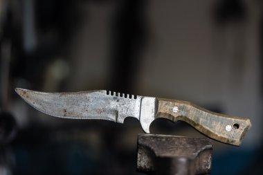 Brutal knife on blurred background