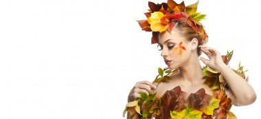 Autumnal woman. Beautiful creative makeup and hair style in fall concept studio shot. Beauty fashion model girl with autumnal make up and hair style. Fall. Creative Autumn makeup. Gorgeous redhead.