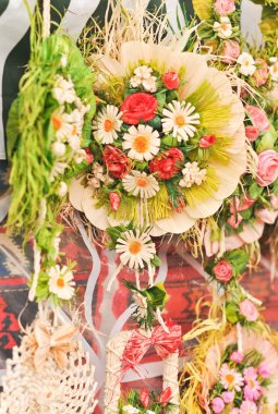 Colorful artificial flowers decorations. Decorative arrangement of various flowers at Romanian market