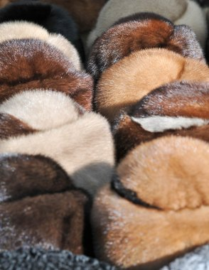 Market in Romania: fur caps. Various winter hats made from animal fur