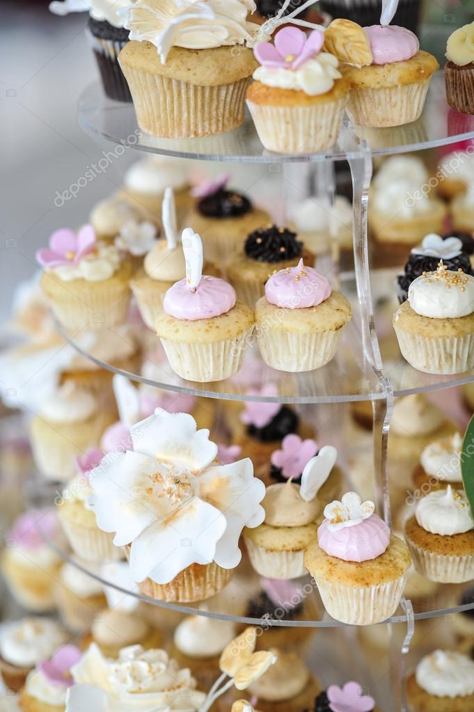 Wedding Decoration With Pastel Colored Cupcakes Meringues Muffins And Macarons Elegant And Luxurious Event Arrangement With Colorful Macaroons Wedding Dessert With Macaroons Stock Photo C Iancucristi 79983514