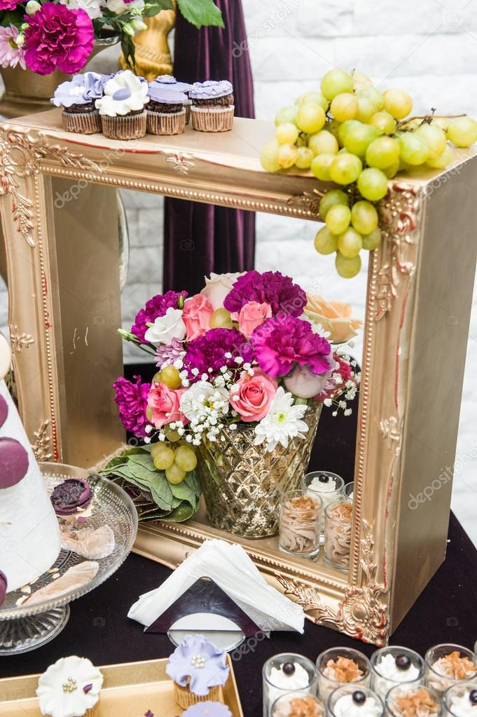 Decoration with pink, white and red flowers in golden wooden