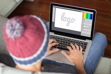 man on sofa designing logo