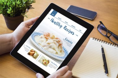 man holding online recipes device
