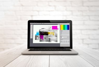 laptop with graphic design software