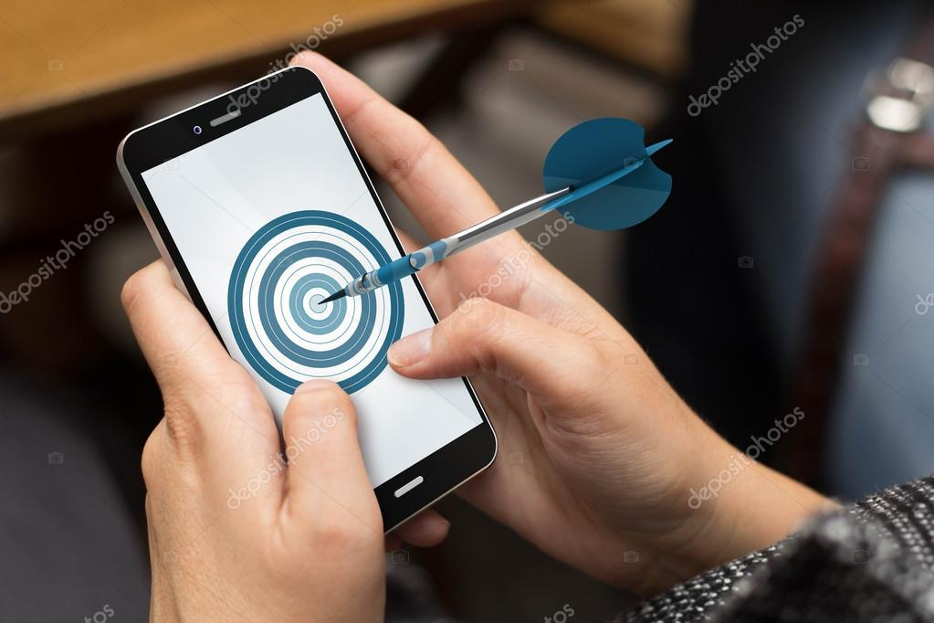 girl using smartphone with target on the screen