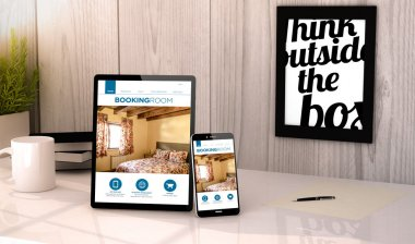 tablet and phone with booking hotel reservation