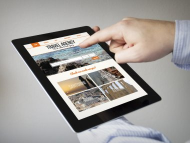 hands with touchscreen tablet