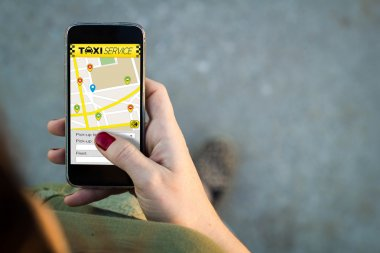 Woman walking with smartphone taxi service app