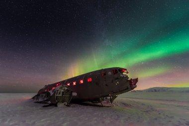 northern lights over plane wreck
