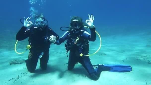 Two scuba Divers having fun