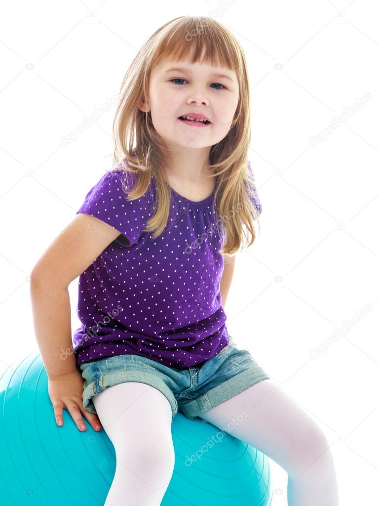 Charming little girl in blue shorts playing — Stock Photo ...