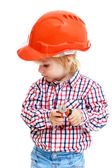 Photo little boy in the construction helmet