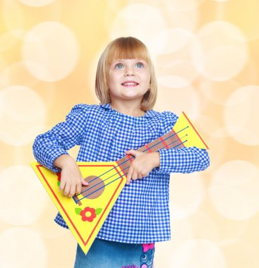 Cheerful little girl with the layout