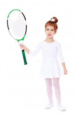 little girl with a tennis racket in his hand
