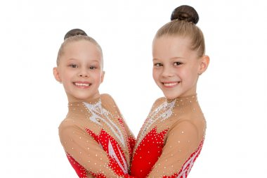 Two sisters funny gymnasts hugging each other