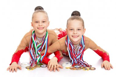 Girls gymnasts show medals
