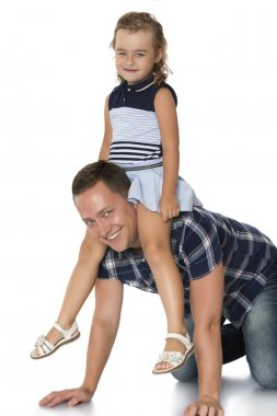 Girl sitting on dads neck