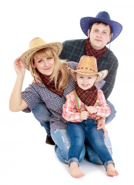 Family in cowboy costumes