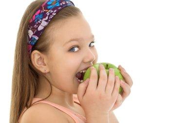 The girl bites the Apple