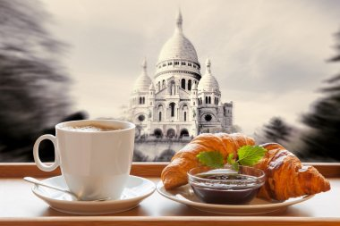 Paris cafe with croissants against Sacre Coeur basilica in France