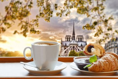 Notre Dame cathedral with coffee and croissants in Paris, France