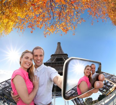 Couple Taking Selfie by Eiffel Tower in Paris, France