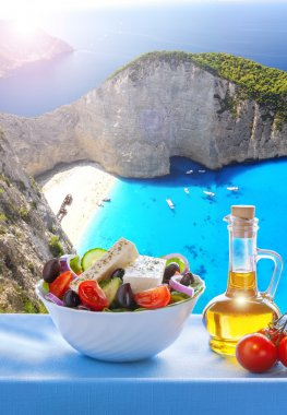 Navagio beach with Greek salad in Zakynthos, Greece