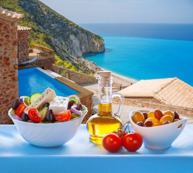 Lefkada island with Greek salad in Greece